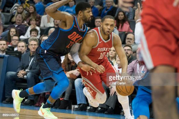 Paul George of the Oklahoma City Thunder applies pressure to Eric Gordon of the Houston Rockets during the second half of a NBA game at the...
