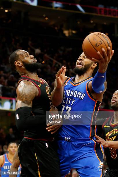 Paul George of the Oklahoma City Thunder attempts to shoot the ball while being defended by LeBron James of the Cleveland Cavaliers during the second...