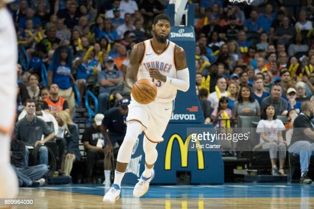 Paul George of the Oklahoma City Thunder brings the ball down court against Melbourne United during the first half of a NBA preseason game at the...