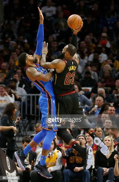 Paul George of the Oklahoma City Thunder defends against LeBron James of the Cleveland Cavaliers during the second quarter at Quicken Loans Arena on...