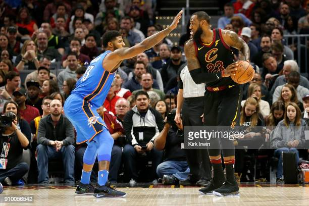 Paul George of the Oklahoma City Thunder defends against LeBron James of the Cleveland Cavaliers during the game at Quicken Loans Arena on January 20...