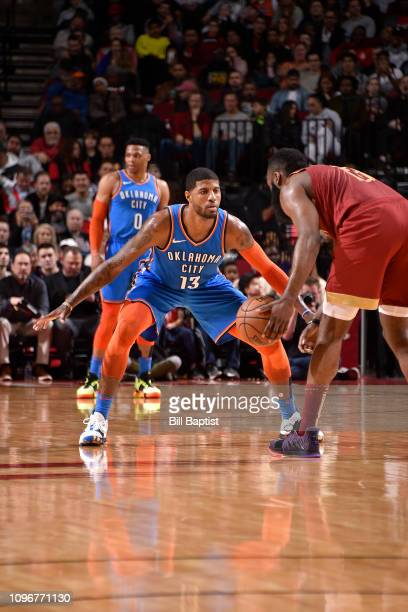 Paul George of the Oklahoma City Thunder defends James Harden of the Houston Rockets on February 9 2019 at the Toyota Center in Houston Texas NOTE TO...