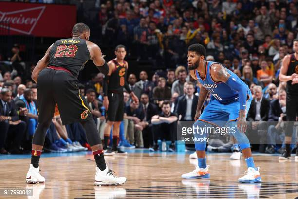 Paul George of the Oklahoma City Thunder defends LeBron James of the Cleveland Cavaliers during the game on February 13 2018 at Chesapeake Energy...