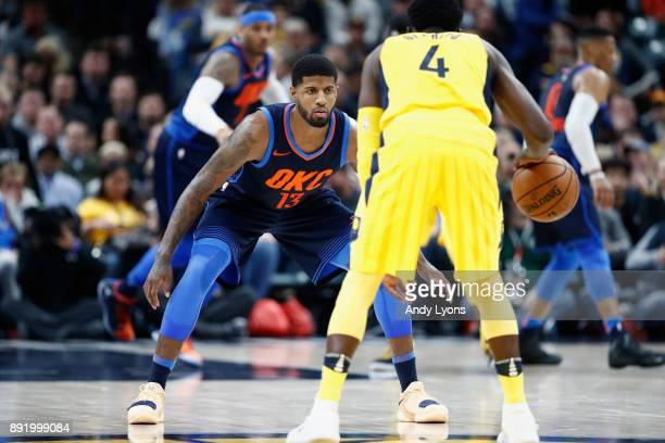 Paul George of the Oklahoma City Thunder defends Victor Oladipo of Indiana Pacers during the game at Bankers Life Fieldhouse on December 13 2017 in...