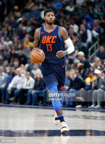 Paul George of the Oklahoma City Thunder dribbles the ball against the Indiana Pacers at Bankers Life Fieldhouse on December 13 2017 in Indianapolis...