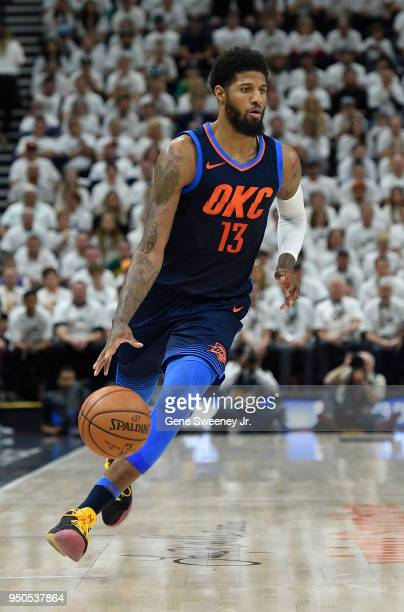 Paul George of the Oklahoma City Thunder dribbles the ball during Game Four of Round One of the 2018 NBA Playoffs against the Utah Jazz at Vivint...