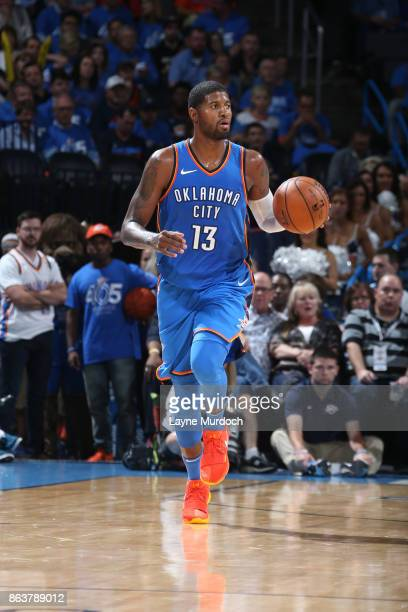 Paul George of the Oklahoma City Thunder dribbles the ball up court against the New York Knicks on October 19 2017 at Chesapeake Energy Arena in...