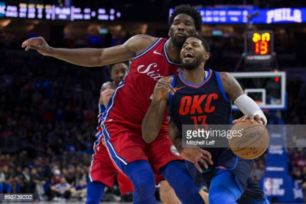 Paul George of the Oklahoma City Thunder drives to the basket against Joel Embiid of the Philadelphia 76ers in double overtime at the Wells Fargo...