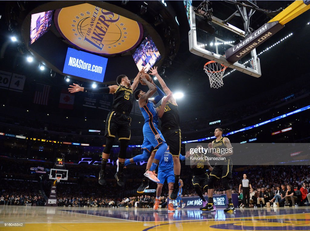 Paul George #13 of the Oklahoma City Thunder drives to the basket against Josh Hart #5 and Brook Lopez #11 of the Los Angeles Lakers during the first half of a basketball game at Staples Center on February 8, 2018 in Los Angeles, California.