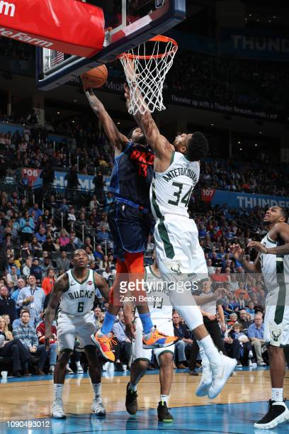 Paul George of the Oklahoma City Thunder dunks against Giannis Antetokounmpo of the Milwaukee Bucks on January 27 2019 at Chesapeake Energy Arena in...