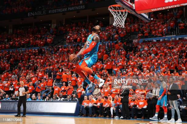 Paul George of the Oklahoma City Thunder dunks the ball against the Portland Trail Blazers during Round One Game Three of the 2019 NBA Playoffs on...