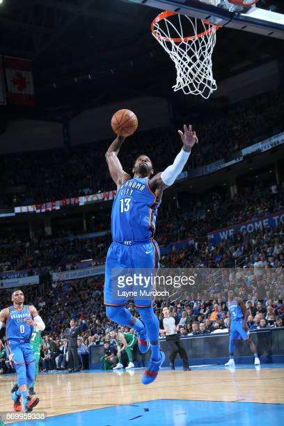 Paul george celtics stock photos and pictures getty images paul george of the oklahoma city thunder dunks the ball against the boston celtics on november voltagebd Gallery