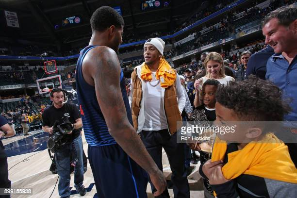 Paul George of the Oklahoma City Thunder gives sneakers to the son of former NBA player Monta Ellis after the game against the Indiana Pacers on...