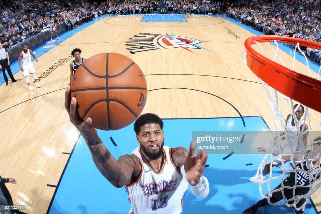 Paul George #13 of the Oklahoma City Thunder goes to the basket against the Sacramento Kings on March 12, 2018 at Chesapeake Energy Arena in Oklahoma City, Oklahoma.
