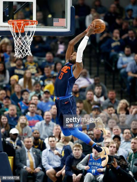 Paul George of the Oklahoma City Thunder goes up to dunk the ball against the Indiana Pacers at Bankers Life Fieldhouse on December 13 2017 in...