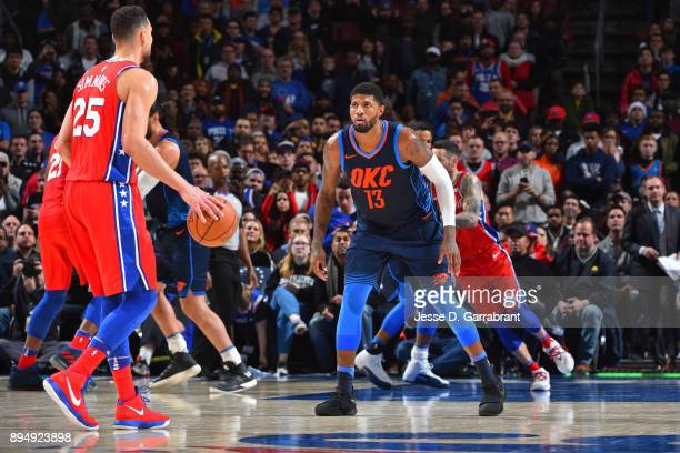 Paul George of the Oklahoma City Thunder guards Ben Simmons of the Philadelphia 76ers at Wells Fargo Center on December 15 2017 in Philadelphia...