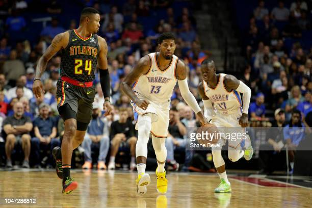 Paul George of the Oklahoma City Thunder handles the ball against Atlanta Hawks during a preseason game on October 7 2018 at BOK Center in Tulsa...