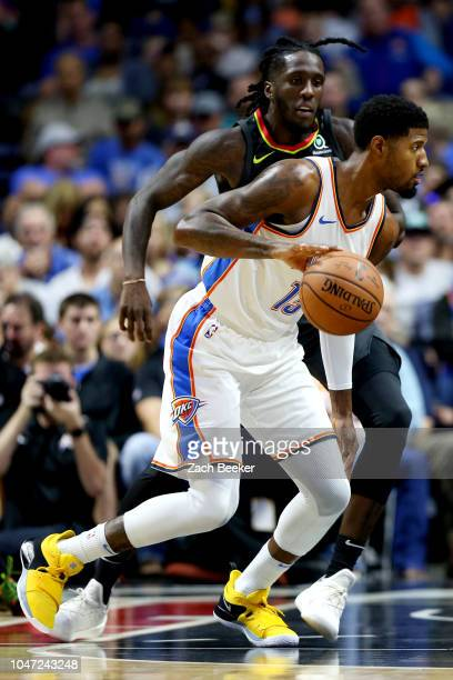 Paul George of the Oklahoma City Thunder handles the ball against the Atlanta Hawks during a preseason game on October 7 2018 at BOK Center in Tulsa...