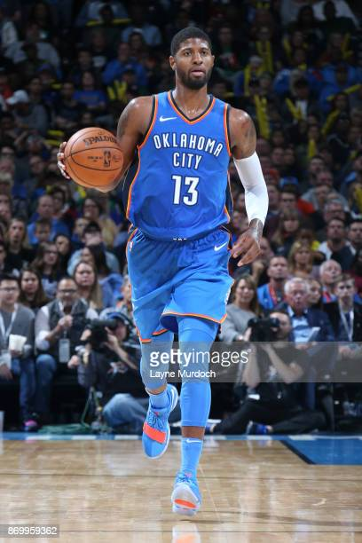 Paul George of the Oklahoma City Thunder handles the ball against the Boston Celtics on November 3 2017 at Chesapeake Energy Arena in Oklahoma City...