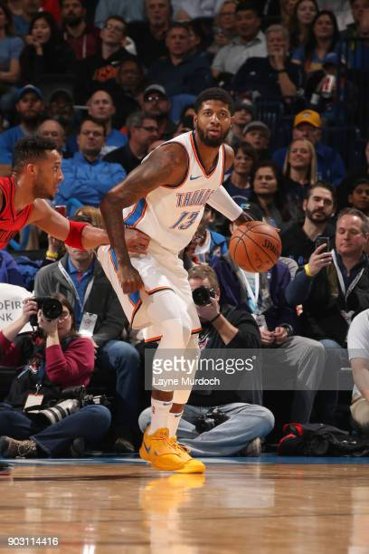 Paul George of the Oklahoma City Thunder handles the ball against the Portland Trail Blazers on January 9 2018 at Chesapeake Energy Arena in Oklahoma...