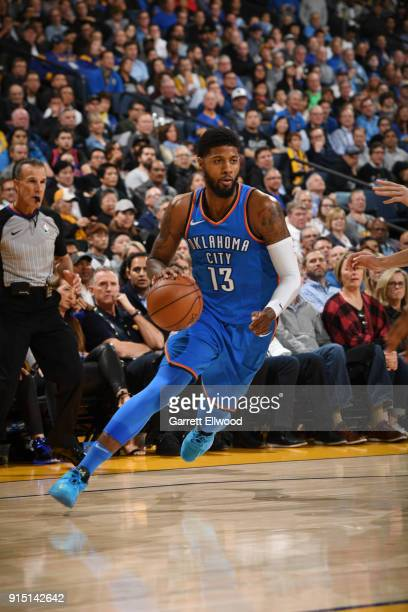 Paul George of the Oklahoma City Thunder handles the ball against the Golden State Warriors on February 6 2018 at ORACLE Arena in Oakland California...