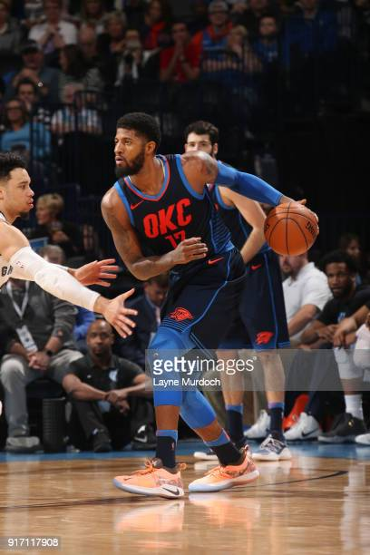 Paul George of the Oklahoma City Thunder handles the ball against the Memphis Grizzlies on February 11 2018 at Chesapeake Energy Arena in Oklahoma...
