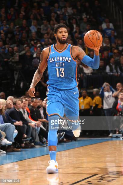 Paul George of the Oklahoma City Thunder handles the ball against the Cleveland Cavaliers on February 13 2018 at Chesapeake Energy Arena in Oklahoma...