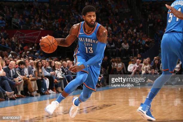 Paul George of the Oklahoma City Thunder handles the ball against the Houston Rockets on March 6 2018 at Chesapeake Energy Arena in Oklahoma City...