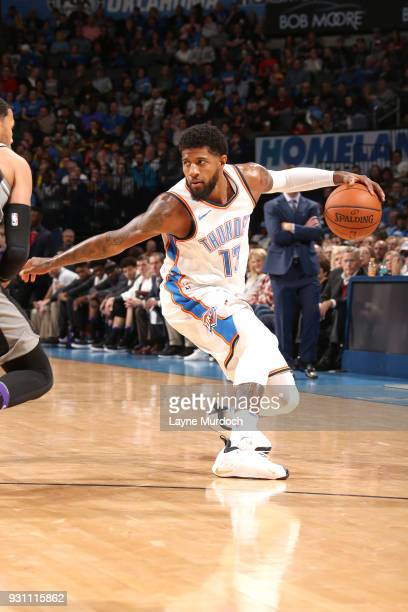 Paul George of the Oklahoma City Thunder handles the ball against the Sacramento Kings on March 12 2018 at Chesapeake Energy Arena in Oklahoma City...