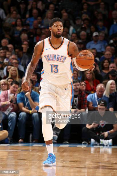 Paul George of the Oklahoma City Thunder handles the ball during the game against the Charlotte Hornets on December 11 2017 at Chesapeake Energy...