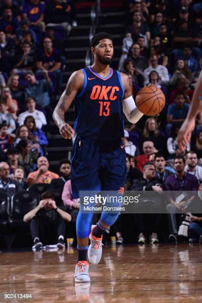 Paul George of the Oklahoma City Thunder handles the ball during the game against the Phoenix Suns on January 7 2018 at Talking Stick Resort Arena in...
