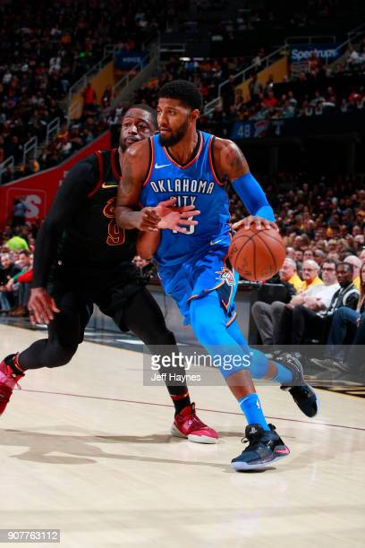 Paul George of the Oklahoma City Thunder handles the ball during the game against the Cleveland Cavaliers on January 20 2018 at Quicken Loans Arena...