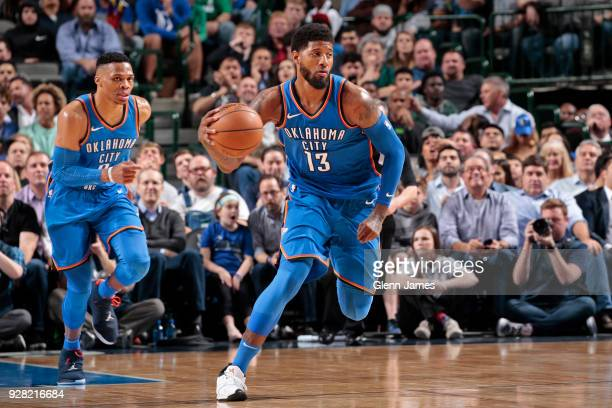 Paul George of the Oklahoma City Thunder handles the ball during the game against the Dallas Mavericks on February 28 2018 at the American Airlines...