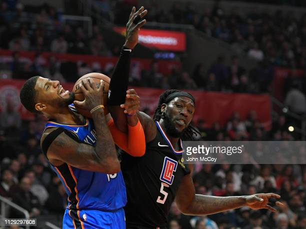 Paul George of the Oklahoma City Thunder is fouled by Montrezl Harrell of the Los Angeles Clippers in the first half at Staples Center on March 8...