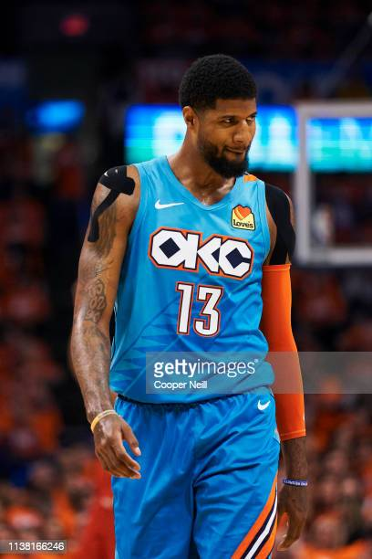 Paul George of the Oklahoma City Thunder looks on against the Portland Trail Blazers during the first half of game three of the Western Conference...