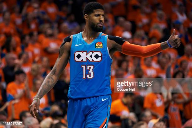 Paul George of the Oklahoma City Thunder looks on against the Portland Trail Blazers during the second half of game three of the Western Conference...