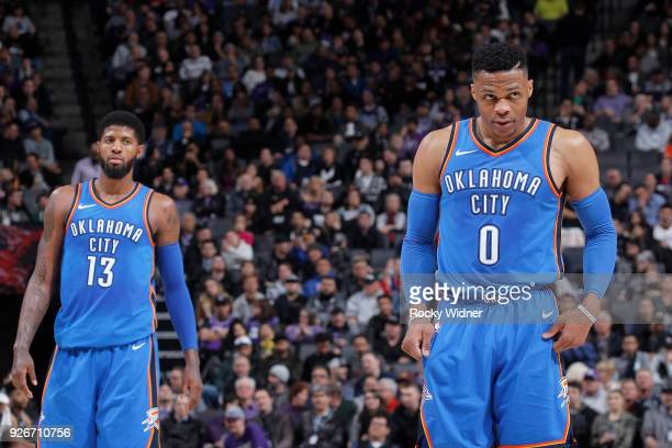 Paul George of the Oklahoma City Thunder looks on as teammate Russell Westbrook approaches the line to shoot free throws against the Sacramento Kings...