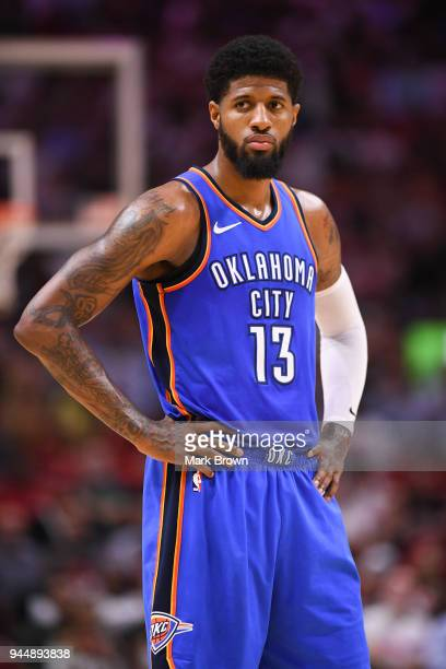 Paul George of the Oklahoma City Thunder looks to the bench during the game against the Miami Heat at American Airlines Arena on April 9 2018 in...