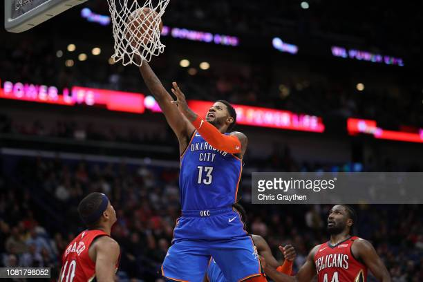 Paul George of the Oklahoma City Thunder makes a shot over Tim Frazier of the New Orleans Pelicans at Smoothie King Center on December 12 2018 in New...