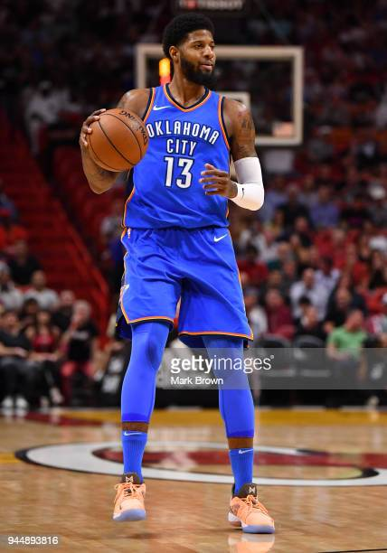 Paul George of the Oklahoma City Thunder moves up the court during the game against the Miami Heat at American Airlines Arena on April 9 2018 in...