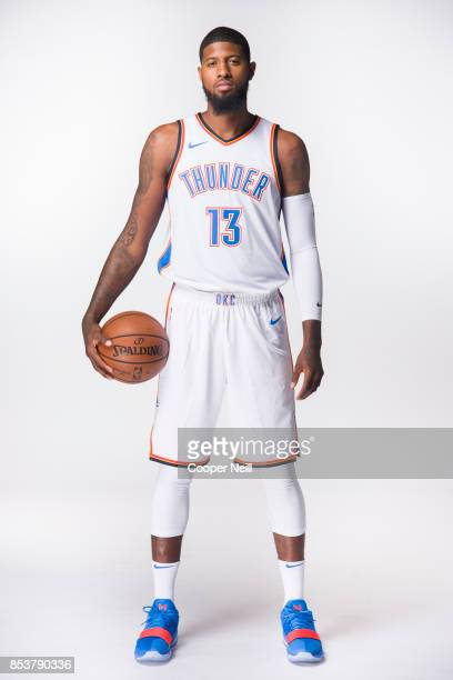 Paul George of the Oklahoma City Thunder poses for a photo during media day at Chesapeake Energy Arena on September 25 2017 in Oklahoma City Oklahoma...