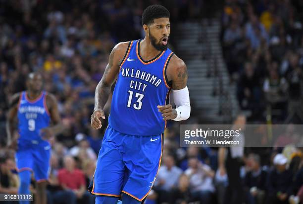 Paul George of the Oklahoma City Thunder reacts after making a threepoint shot over Kevin Durant of the Golden State Warriors during the second half...