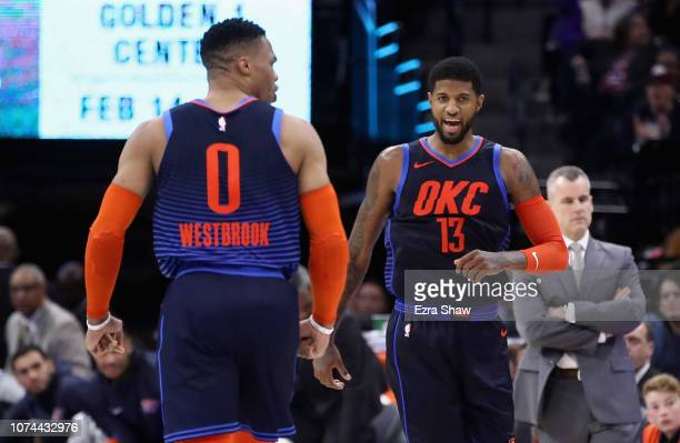 Paul George of the Oklahoma City Thunder reacts with Russell Westbrook after George made a basket against the Sacramento Kings at Golden 1 Center on...