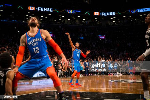 Paul George of the Oklahoma City Thunder shoots a three pointer game winning shot against the Brooklyn Nets late in the fourth quarter on December 5...