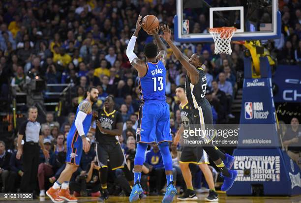 Paul George of the Oklahoma City Thunder shoots a threepoint shot over Kevin Durant of the Golden State Warriors during the second half of their NBA...