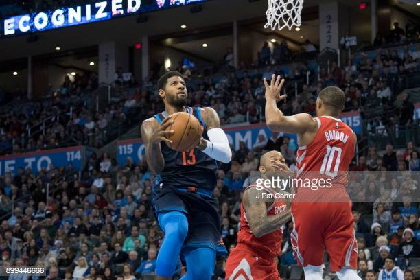 Paul George of the Oklahoma City Thunder shoots against the Houston Rockets during the first half of a NBA game at the Chesapeake Energy Arena on...