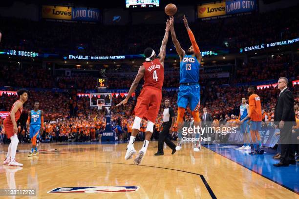 Paul George of the Oklahoma City Thunder shoots the ball against Maurice Harkless of the Portland Trail Blazers during the second half of game three...