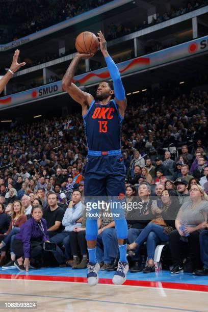 Paul George of the Oklahoma City Thunder shoots the ball against the Sacramento Kings on November 19 2018 at Golden 1 Center in Sacramento California...