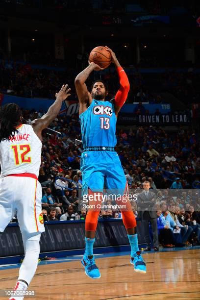 Paul George of the Oklahoma City Thunder shoots the ball against the Atlanta Hawks on November 30 2018 at Chesapeake Energy Arena in Oklahoma City...