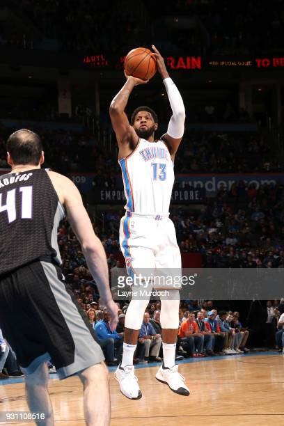 Paul George of the Oklahoma City Thunder shoots the ball against the Sacramento Kings on March 12 2018 at Chesapeake Energy Arena in Oklahoma City...